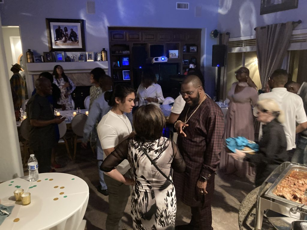 How to host a covid friendly event Gathering of multicultural and multi generational people in the family room dancing and celebrating the birthday boy.
